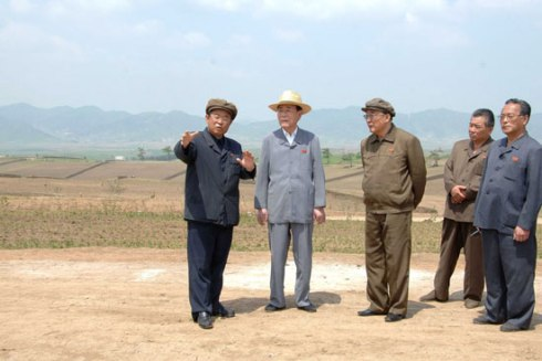 SPA Presidium President Kim Yong Nam is briefed about the development of the Sep'o Tableland in Kangwo'n Province (Photo: Rodong Sinmun).