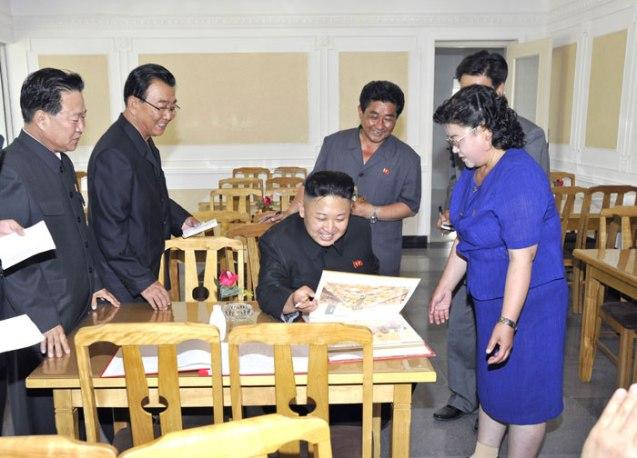 Kim Jong Un reads a menu at the Ch'angso'ng Restaurant (Photo: Rodong Sinmun).