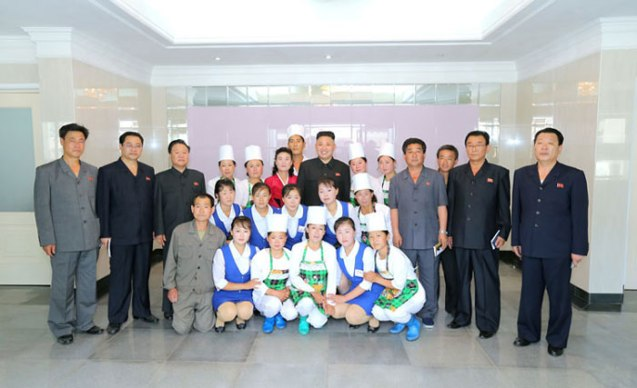 Kim Jong Un poses for a commemorative photograph with restaurant employees in Ch'angso'ng County, North P'yo'ngan Province (Photo: Rodong Sinmun).