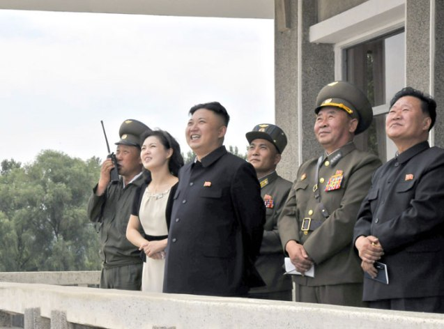 Kim Jong Un watches flight training by KPA Air Force Unit #1017.  Also seen in attendance is his wife Ri Sol Ju  2nd L), KPA Air Force Commander Gen. Ri Pyong Chol (4th L) and VMar Choe Ryong Hae (5th L) (Photo: Rodong Sinmun).