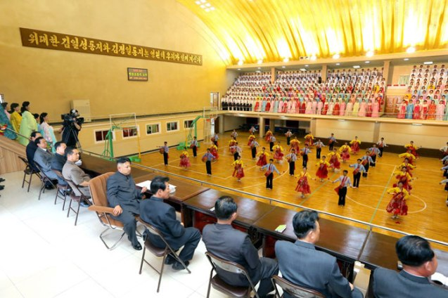 "Kim Jong Un watches the performance ""Our Plant Shining with the Bloodline of Mt. Paektu"" by the Kanggye General Machine Plant's art propaganda squad (Photo: Rodong Sinmun)."