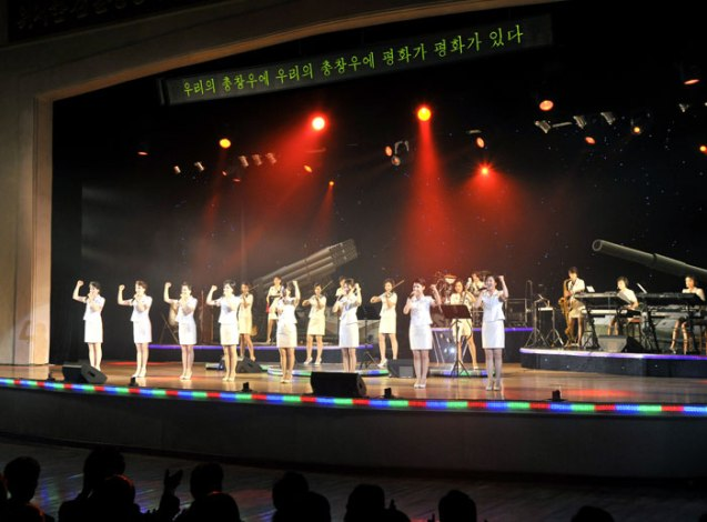 The Moranbong Band gives a concert for workers in Chagang Province (Photo: Rodong Sinmun).