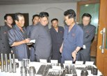 Kim Jong Un (2nd L) is briefed about some of the products of Jangjagang Machine Tools Plant in Kanggye, Chagang Province (Photo: Rodong Sinmun).
