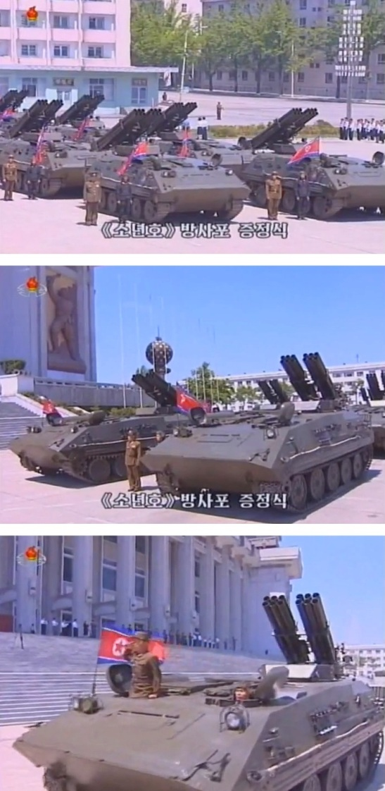 Sonyonho multiple rocket launch systems [MRLS] are paraded by the Hamhu'ng Grand Theater for delivery to KPA units, after a 1 June 2013 ceremony at which Korean Children's Union members donated the MLRS to the KPA (Photos: KCTV screengrabs)