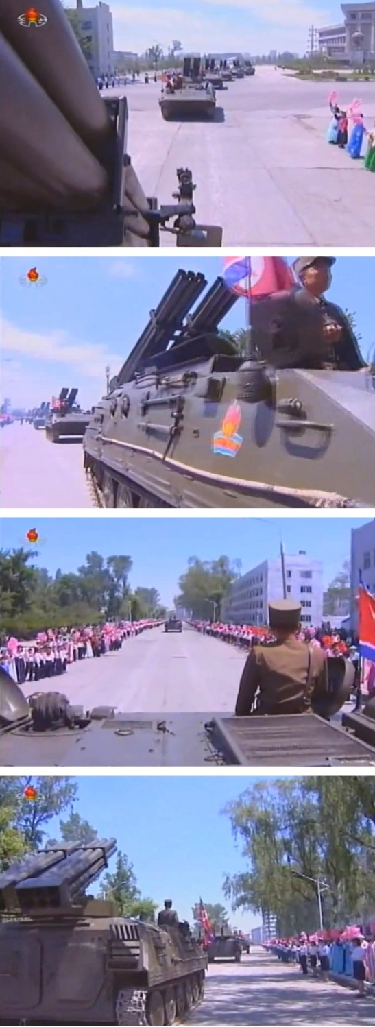 Sonyonho (children) multiple launch rocket systems [MLRS] parade through Hamhu'ng's city centre on 1 June 2013 for delivery to Korean People's Army units (Photos: KCTV screengrabs)