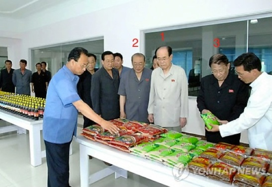 SPA Presidium President Kim Yong Nam (1), the DPRK's head of state, is briefed about food production touring a visit by senior DPRK officials.  Also seen in attendance is SPA Presidium Vice President Yang Hyong Sop (2) and DPRK Vice Premier Kang Sok Ju (3) (Photo: KCNA-Yonhap).