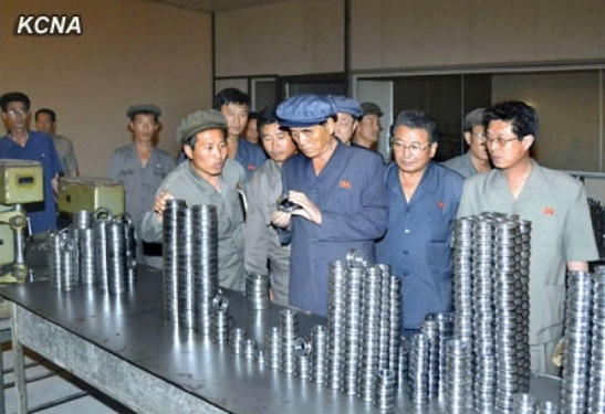 DPRK Premier Pak Pong Ju examines products of the Ryangchaek Bearings Factory (Photo: KCNA).