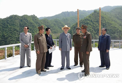 Kim Yong Nam (4th L), the DPRK's official head of state as President of the Supreme People's Assembly Presidium, tours the Masik Pass Ski Ground on 9 June 2013 (Photo: KCNA-Yonhap)