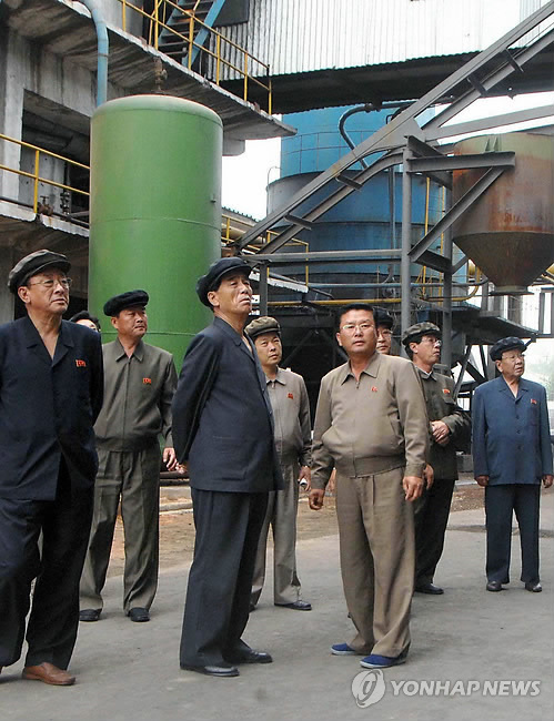 DPRK Premier Pak Pong Ju (3rd L) tours a factory in Hamhu'ng, capital of South Hamgyo'ng Province (Photo: KCNA-Yonhap)
