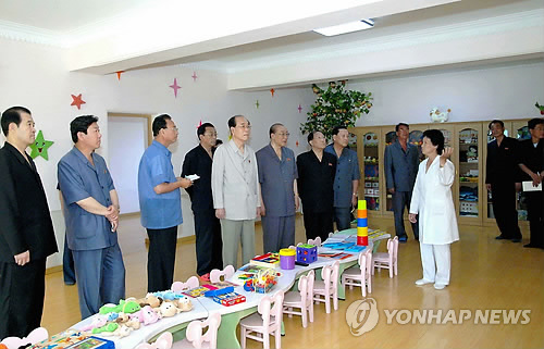 SPA Presidium President Kim Yong Nam and other senior DPRK government officials tour a childcare classroom at Pyongyang Essential Foodstuffs Factory (Photo: KCNA-Yonhap).