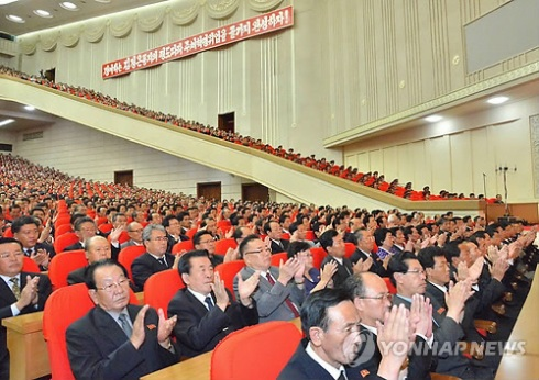 Participants at a national meeting commemorating the 49th anniversary of the start of Kim Jong Il's work at the Party Central Committee, held at 25 April House of Culture on 18 June 2013 (Photo: KCNA-Yonhap).