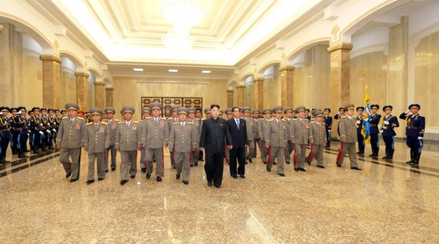 Kim Jong Un (6th L) visits the Ku'msusan Palace of the Sun with senior DPRK officials on 8 July 2013, the 19th anniversary of the death of his paternal grandfather, late DPRK founder and president Kim Il Sung (Photo: Rodong Sinmun).