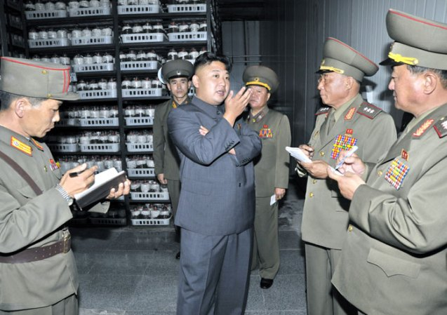 Kim Jong Un issues instructions to senior KPA officials and commanders of KPA Unit #534 during a tour of a mushroom farm recently constructed by the unit (Photo: Rodong Sinmun).