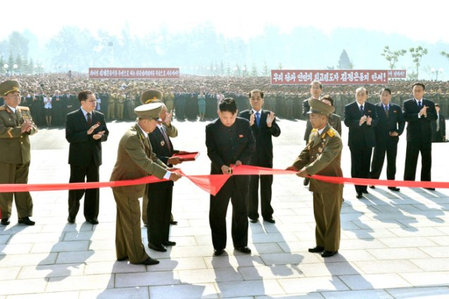 Kim Jong Un cuts a ceremonial ribbon to open the Fatherland Liberation War Martyrs' Cemetery in Pyongyang on 25 July 2013.  Also seen in attendance standing behind Kim Jong Un are Gen. Kim Kyok Sik (L), Jang Song Taek (2nd L), Pak Pong Ju (5th R),  Choe Tae Bok (4th R) , Yang Hyong Sop (3rd R) Kang Sok Ju (2nd R) and Kim Yang Gon (R) (Photo: Rodong Sinmun).