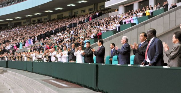 Kim Jong Un, senior DPRK officials and heads of foreign government delegations applaud during a national report meeting commemorating the 60th anniversary of the termination of active hostilities of the Korean (Fatherland Liberation) War at May Day Stadium in Pyongyang on 26 July 2013.  Among those seen in attendance is Kim Kyong Hui (R), eldest daughter of the late DPRK President and founder Kim Il Sung (Photo: Rodong Sinmun).