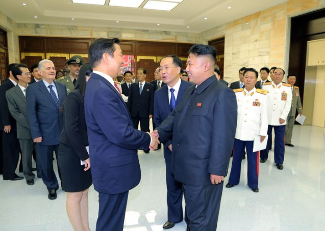 Kim Jong Un (R) shakes hands with Chinese Vice President Li Yuanchao (L) during an event for foreign government and political party delegations in Pyongyang on 27 July 2013 (Photo: Rodong Sinmun).