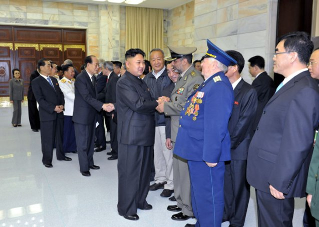 Kim Jong Un shakes hands with the heads of foreign military delegations on 26 July 2013.  Seen in the background, L, is his aunt KWP Secretary Kim Kyong Hui (Photo: Rodong Sinmun).