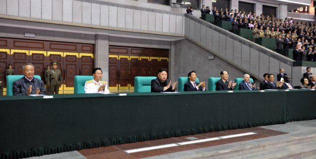 Kim Jong Un (3rd L) and PRC Vice President Li Yuanchao (4th L) applaud during a performance of the Arirang mass games at Kim Il Sung Stadium in Pyongyang on 26 July 2013 (Photo: Rodong Sinmun).