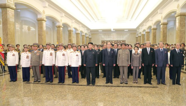 Kim Jong Un (C) visits Ku'msusan Palace of the Sun in Pyongyang on 27 July 2013 to pay his respects to his father, late leader Kim Jong Il, and his grandfather, late DPRK President and founder Kim Il Sung.  Also seen in attendance with him are Gen. Kim Won Hong (L), VMar Kim Yong Chun (2nd L), Col. Gen. Jang Jong Nam (3rd L) Gen. Kim Kyok Sik (4th L), Jang Song Taek (5th L), VMar Choe Ryong Hae (6th L), Kim Yong Nam (6th R),  Pak Pong Ju (5th R),  Kim Kyong Hui (4th R), Kim Ki Nam (3rd R) Choe Tae Bok (2nd R) and Yang Hyong Sop (R) (Photo: Rodong Sinmun).