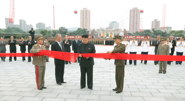 Kim Jong Un (C) cuts a ceremonial ribbon formally opening the renovated Victorious Fatherland Liberation War (Korean War) Museum in Pyongyang on 27 July 2013 (Photo: Rodong Sinmun).