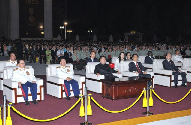 Kim Jong Un (C) watches a fireworks display in Pyongyang on 27 July 2013.  Also in attendance in the first row with him are his uncle NDC Vice Chairman Jang Song Taek (L), Director of the KPA General Political Department VMar Choe Ryong Hae (2nd L), Chinese Vice President Li Yuanchao (2nd R) and SPA Presidium President Kim Yong Nam (R).  In the second row are Chief of the KPA General Staff Gen. Kim Kyok Sik (L) and Kim Jong Un's aunt and Vice Chairman Jang's wife, KWP Secretary and department director Kim Kyong Hui (3rd R) (Photo: Rodong Sinmun).