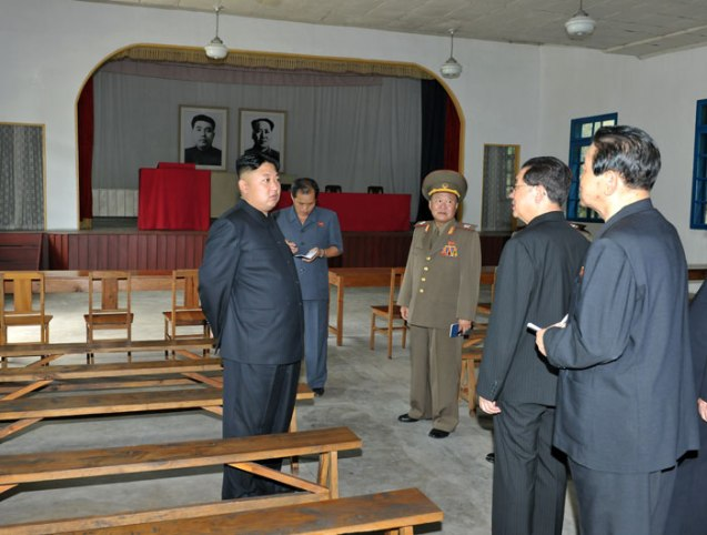 Jang Song Taek (2nd R), Vice Chairman of the National Defense Commission and Kim Jong Un's uncle, talks to Kim Jong Un (L) during a tour of the Songhung Revolutionary Site on 29 July 2013 (Photo: Rodong Sinmun).