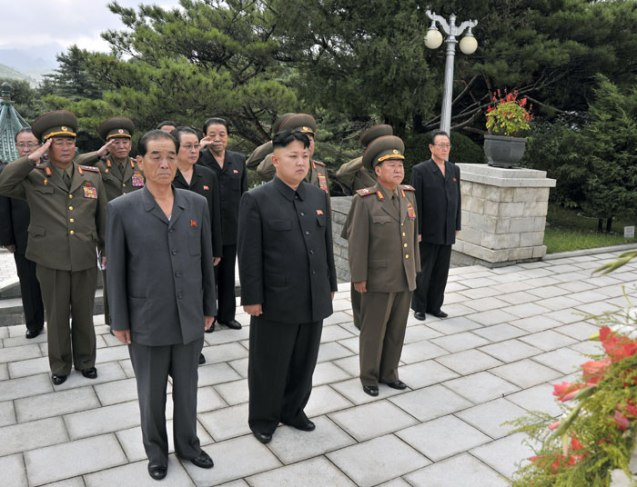 Kim Jong Un (1st row, C) visits the Chinese People's Volunteers Martyrs' Cemetery in Hoech'ang County, South P'yo'ngan Province on 29 July 2013 (Photo: Rodong Sinmun).