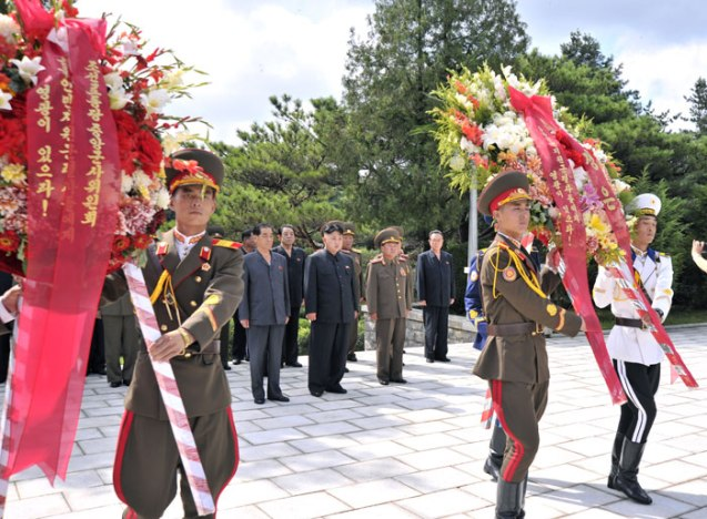 A Korean People's Army honor guard delivers floral wreaths to a monument in the CPV Martyrs' Cemetery in Hoech'ang County, South P'yo'ngan Province on 29 July 2013 (Photo: Rodong Sinmun).