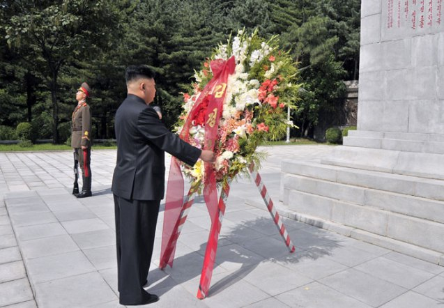 Kim Jong Un arranges a wreath on a floral basket delivered in his name to a monument at the CPV Martyrs' Cemetery in Hoech'ang County, South P'yo'ngan Province (Photo: Rodong Sinmun).