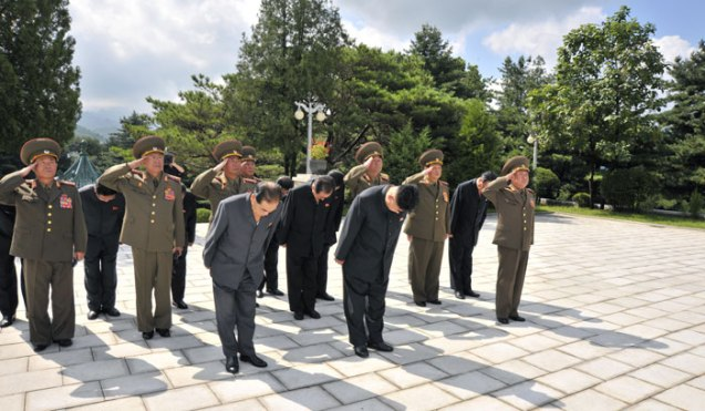 Kim Jong Un (1st Row, C) bows in front of a monument in the CPV Martyrs' Cemetery in Hoech'ang County, South P'yo'ngan Province, on 29 July 2013 (Photo: Rodong Sinmun).