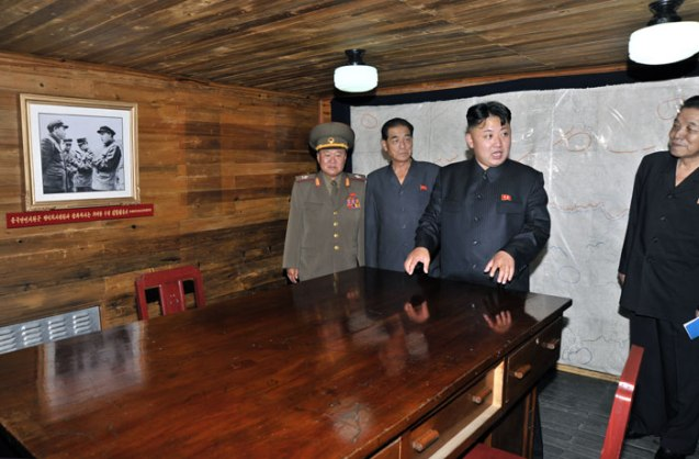 Kim Jong Un tours a room at the Songhung Revolutionary Site on 29 July 2013.  Seen in attendance behind him are: VMar Choe Ryong Hae (L), Pak Pong Ju (2nd L) and Kim Kyong Ok (R) (Photo: Rodong Sinmun).