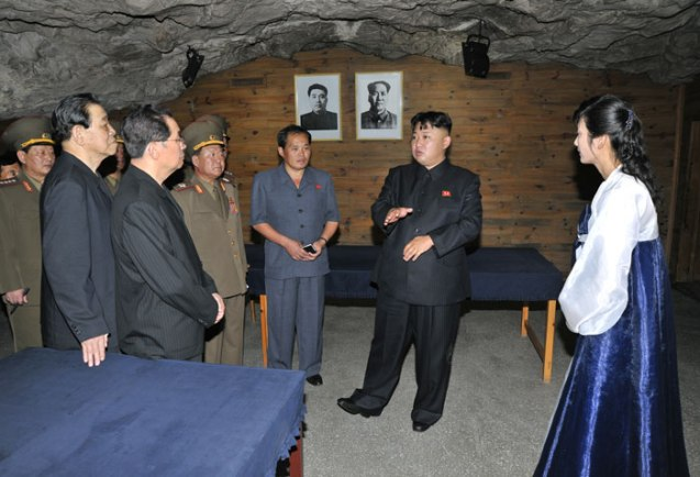 Kim Jong Un (2nd R) tours the Songhung Revolutionary Site on 29 July 2013 (Photo: Rodong Sinmun).