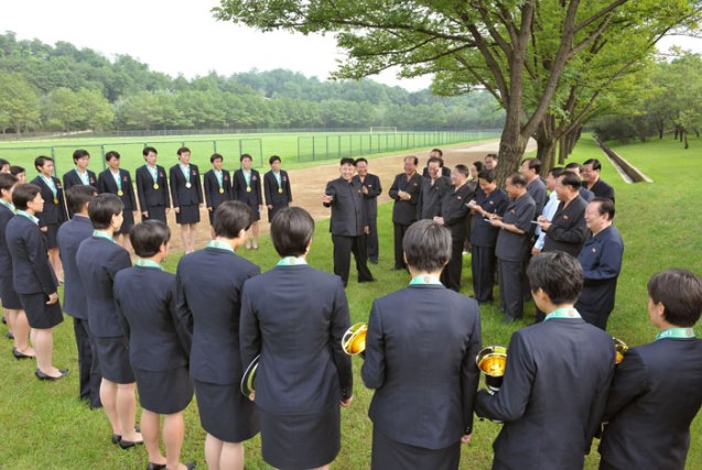 Kim Jong Un meets with DPRK women footballers who won the 2013 EAFF Championship which were held in Seoul ROK on 27 July 2013 (Photo: Rodong Sinmun).