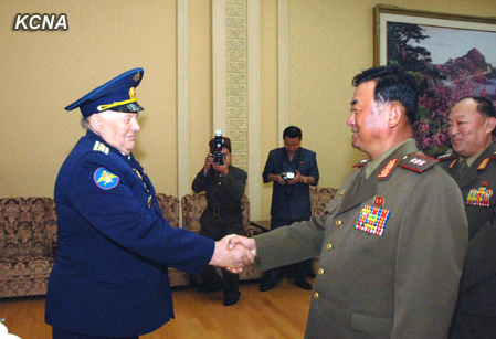 Minister of the People's Armed Forces Col. Gen. Jang Jong Nam (R) shakes hands with Korean War Veterans Council of Russia Vice Chairman Ya. V. Kanov (L) in Pyongyang on 30 July 2013 (Photo: KCNA).