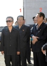 Hong Sok Hyong (1) served as Director of the KWP Finance and Planning Department from June 2010 to June 2011.  Pak Nam Gi (2) oversaw the establishment of the KWP Finance and Planning Department and served as its director from 2005 to 2010.  They are seen attending a guidance tour with late DPRK leader Kim Jong Il in North Hamgyo'ng Province in the summer of 2009 (Photo: NK Leadership Watch/KCNA file photo).