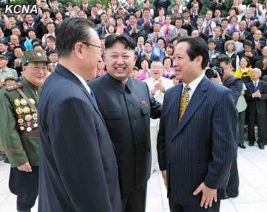 Kim Jong Un (2nd R) talks with a delegation head (R) and KWP Secretary and Director of the United Front Kim Yang Gon (2nd L).  Seen in the background, L, is Korean War veteran and SPA Presidium Vice President Yang Hyong Sop (Photo: KCNA).