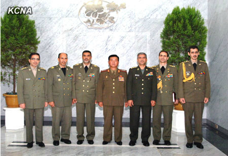 Minister of the People's Armed Forces, Col. Gen. Jang Jong Nam (C) poses for a commemorative photograph with an Iranian military delegation in Pyongyang on 25 July 2013 (Photo: KCNA)