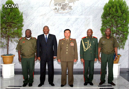 Minister of the People's Armed Forces Col. Gen. Jang Jong Nam (C) poses for a commemorative photograph with a military delegation from Mozambique in Pyongyang on 25 July 2013 (Photo: KCNA).