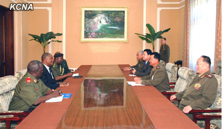 Col. Gen. Jang Jong Nam and senior Korean People's Army officials (R) meet with Agostinho Salvador Mondlane and a delegation of the Armed Forces for the Defense of Mozambique (L) in Pyongyang on 25 July 2013 (Photo: KCNA).