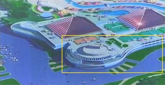 A planned structure planned on the southern perimeter of the Munsu Wading Pool.  A structure with a similar design is planned to abut this building and can be seen in the bottom right of the design's poster (Photo: KCTV/KCNA screengrab).