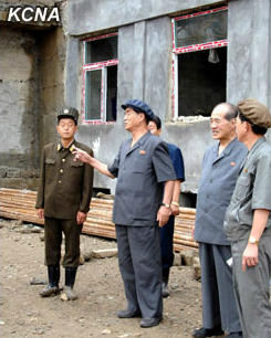 DPRK Cabinet Premier Pak Pong Ju (2nd L) tours the construction of apartments which upon completion will house DPRK scientists (Photo: KCNA).