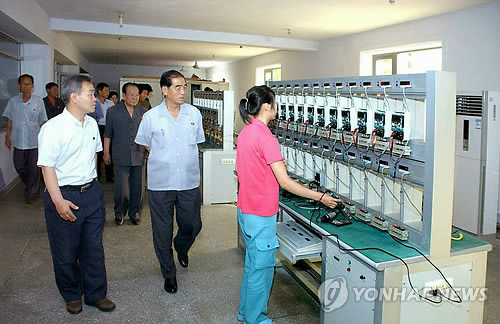 DPRK Premier Pak Pong Ju (2nd R) tours the Pyongyang Electrical Appliances Joint Venture Company (Photo: KCNA-Yonhap).