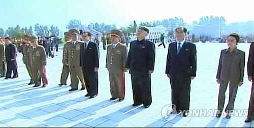 Kim Jong Un (3rd R) attends a ceremony opening the Fatherland Liberation War Martyrs' Cemetery in Pyongyang on 25 July 2013.  Also seen in attendance is his aunt KWP Secretary Kim Kyong Hui (R), DPRK Premier Pak Pong Ju (2nd R), VMar Choe Ryong Hae (4th R), NDC Vice Chairman Jang Song Taek (5th R) and Chief of the KPA General Staff Gen. Kim Kyok Sik (6th R) (Photo: KCTV-Yonhap).
