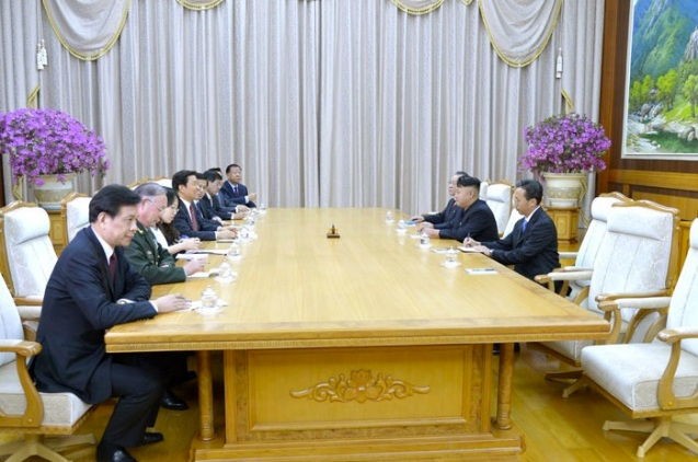 Kim Jong Un (R) meets with Chinese Vice President Li Yuanchao and a PRC delegation (L) at a state guesthouse in Pyongyang on 25 July 2013 (Photo: Rodong Sinmun).