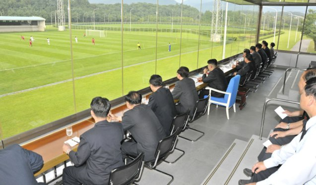 Kim Jong Un and senior DPRK officials watch a football (soccer) match between the Hwaebul and 25 April teams (Photo: Rodong Sinmun).