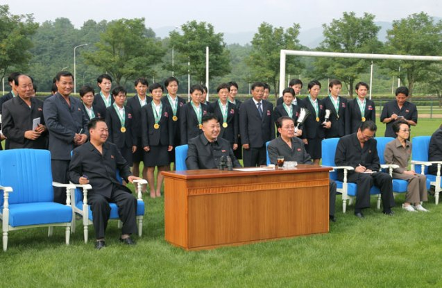 Kim Jong Un watches an archery competition between the 25 April Defense Sports Team and the Amnokgang Defense Sports Team.  Among those also seen attending the competition are the DPRK women's football (soccer) squad who won the 2013 EAFF cup, Jon Yong Nam (standing, 2nd L), VMar Choe Ryong Hae (seated, 3rd L), Jang Song Taek (seated, 3rd R) and Jang's wife and Kim Jong Un's aunt Kim Kyong Hui (seated, R) (Photo: Rodong Sinmun).