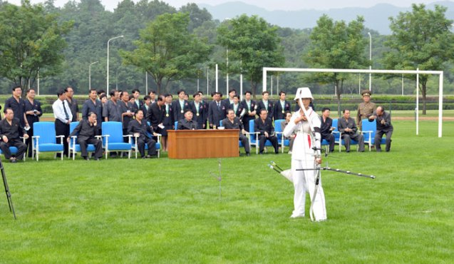 Kim Jong Un (seated, 4th L) watches an archery competition between the Amnokgang Defense Sports Team and the 25 April Defense Sports Team.  Among senior DPRK officials in attendance is DPRK Vice Premier Kang Sok Ju (seated, 2nd L) (Photo: Rodong Sinmun).