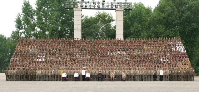 Kim Jong Un poses for a commemorative photograph with Fatherland Liberation War (Korean War) veterans and KPA commanders who participated in the anniversary military parade and demonstration held (Photo: Rodong Sinmun).
