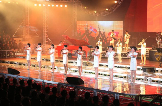 The Moranbong Band perform during a concert for participants in the war anniversary military parade and demonstration (Photo: Rodong Sinmun).