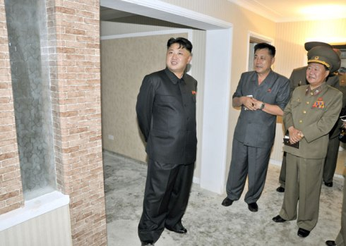 Kim Jong Un (L) tours apartment housing construction.  Also in attendance are Ma Won Chun (2nd L) and VMar Choe Ryong Hae (3rd L) (Photo: Rodong Sinmun).